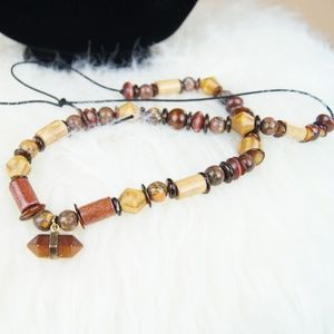 Handcrafted, brown/ tan wooden beaded necklace